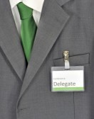 14125253-closeup-on-male-gray-business-suit-green-tie-and-conference-delegate-badge